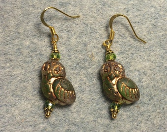 Translucent olive green with gold wash fancy Czech glass owl bead earrings adorned with olive green Chinese crystal beads.