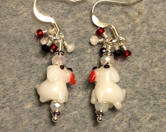 Tiny white puppy dog lampwork bead earrings adorned with white Chinese crystal beads and tiny dangling white and red Chinese crystal beads.