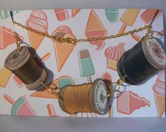 sewing bee thread multi tatty vintage spool necklace woodcut lasercut yellow brown