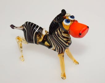 Glass zebra with adorable face expression. Detailed figurine; a lot of personality.  Excellent addition to your glass animals collection.