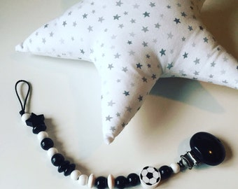 Attached nipple with black and white wooden beads
