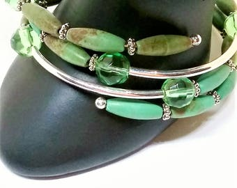 Green memory wire triple wrap bracelet.