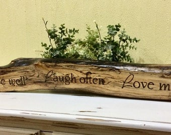 Live Well, Laugh Often, Love much driftwood mantel, ledge, bookcase