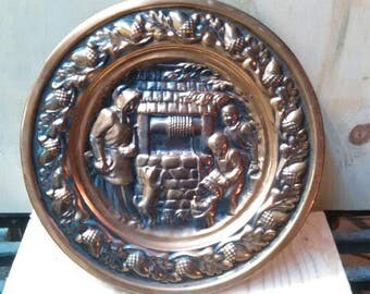 Vintage copper wall hanging plate at the well