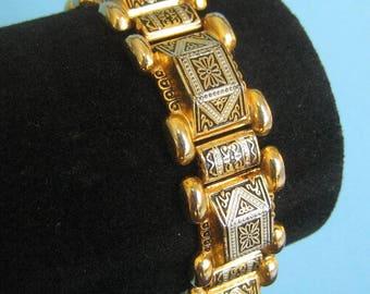 Gold tone, Silver tone, and Black Damascene Bracelet