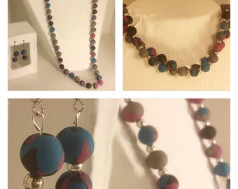 Blue, purple, and black necklace and earring set