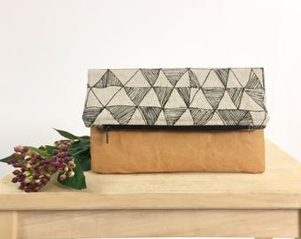Small fold over clutch with washable paper and black geometric pattern. Zipper pouch, purse, bag