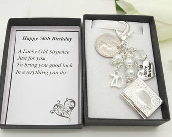 Personalised happy 70th birthday gift. Clear book locket. Random sixpence, charm, keyring,  gift box, choice of heart and number charm