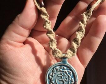 Handmade thick hemp necklace with a raku lotus and ohm pendant