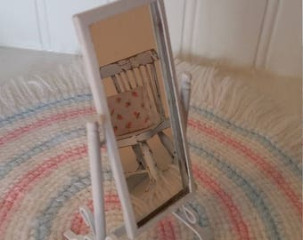 Dollhouse miniature mirror, will reflect anything beautiful in your little home.