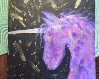 purple and gold unicorn painting