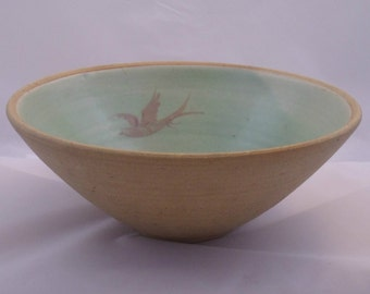 Studio pottery bowl. Deep stoneware bowl with green glaze to the interior decorated with three flying birds.