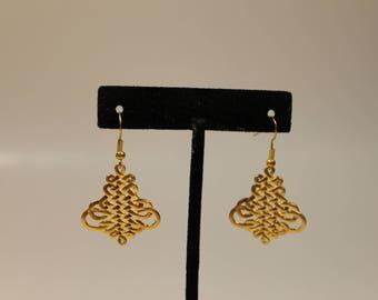 Gold tone scroll drop earrings