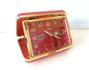 Bradley travel clock, Ruby red