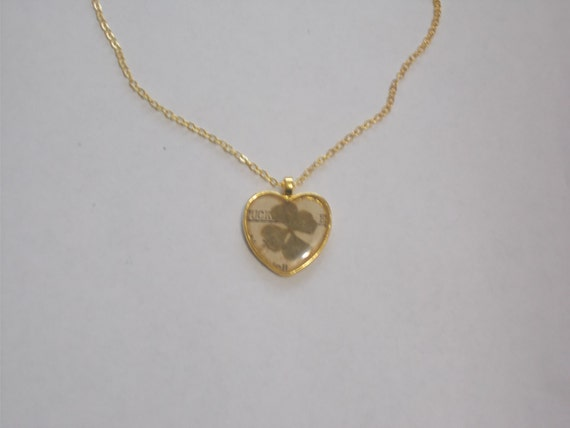 "Four leaf clover in resin, dusted with diamond powder on a 16"" gold plated chain w/heart toggle clasp"
