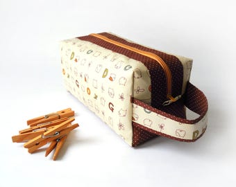 Zippered boxy pouch/make-up/cosmetic pouch with handle, with cute dogs and flowers on a beige background and dark brown accents