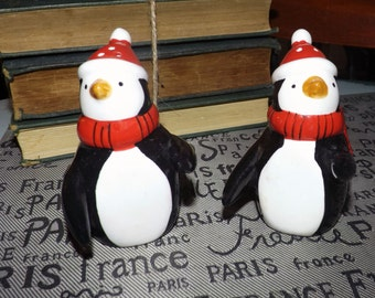 PAIR of figural salt and pepper shakers in the shape of penguins dressed for winter!  Origin unknown, likely Japan.