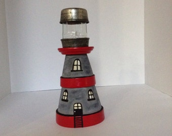 Lighthouse made from clay pots, lighthouse and recycled items