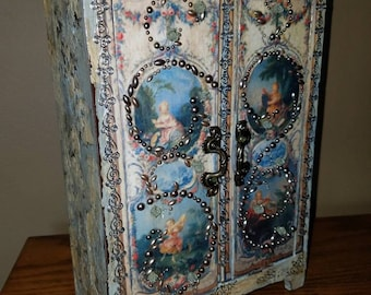 Small embellished cabinet.
