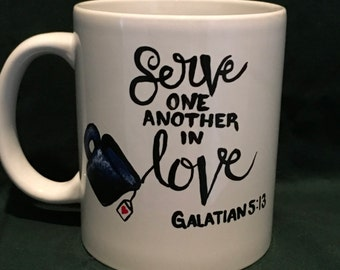 Hand painted serve in love Galatians 5:13 coffee cup
