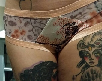 Sweetie undies with sheer floral and paisley fabrics. Please choose a size