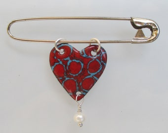 Red circles on a blue background enameled pin with freshwater pearl on a safety pin