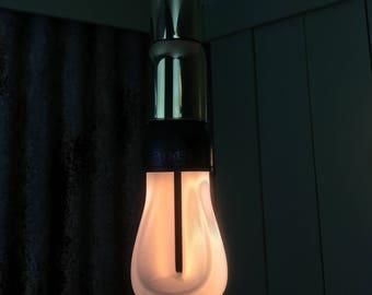 Ryde : A Decopunk inspired polished brass pendant light.