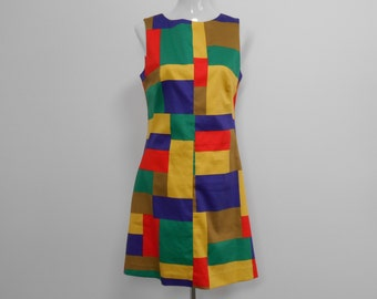 Sleeveless, cotton 1960's style A-line dress has center font seam, fitting darts and back zipper