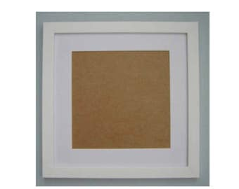 A 14 x 14 inch white picture frame