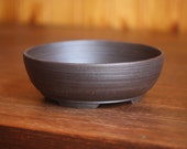 Round dark brown unglazed bonsai pot