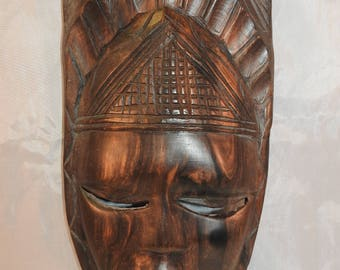 Tribal hand carved wooden mask
