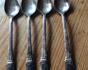"Rogers four piece ""First Love"" spoon set"