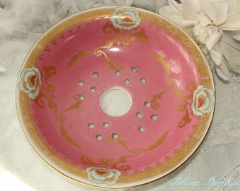 England: Antique pink and blue strainer