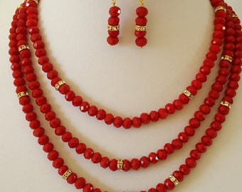 Red 3-strand necklace, bracelet, and earring  set
