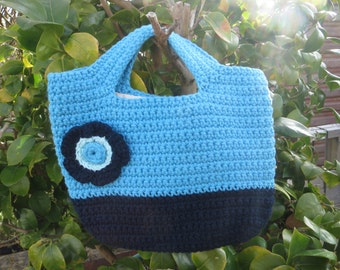 Hand crocheted Handbag in navy and turquise with detachable flower brooch