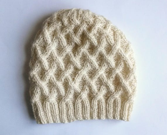 Aran Knit Beanie: handknit cabled hat in 100% wool. Natural fibres, cosy yet lightweight. Original design; cream wool. Timeless style.