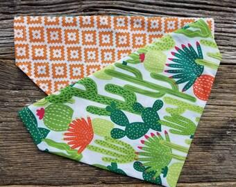 Cactus dog bandana and orange southwest reversible over the collar