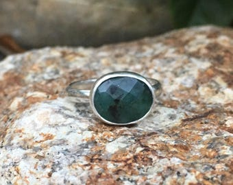 Faceted emerald ring