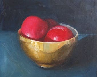 Gold bowl of plums