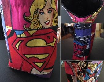 Supergirl (and a slight photo of Batgirl) DC Comics DC Universe dice bag, drawstring bag, coin purse