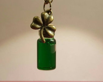 Glass vials in green with clover leaf pendant on bronze chain