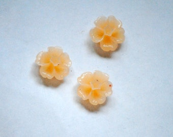 3 resin flower cabochon beads to the stick