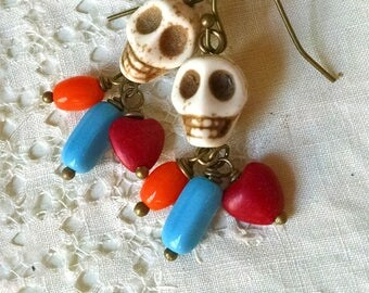 Howlite skull earrings with colorful beaded tassel accent