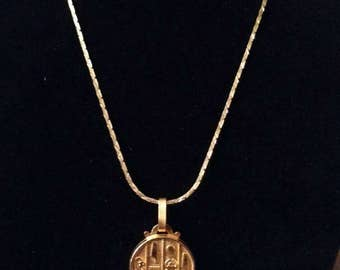 Vintage brass Egyptian hieroglyphics necklace