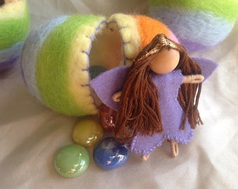 Felted fillable hollow reeusable rainbow Easter egg with fairy and treasure