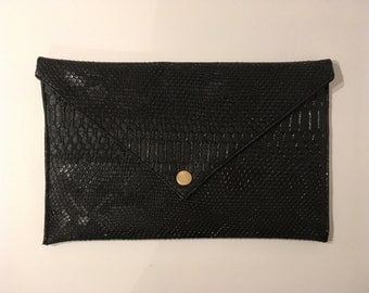 Promo worn envelope hand clutch