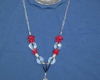 CHAIN NECKLACE.Very fancy!!!Red and baby blue real necklace beads and silver stone in the middle.Silver chain.