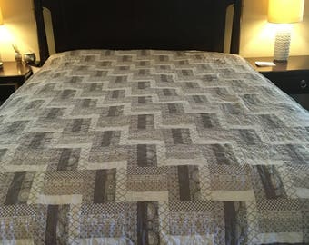 queen sized gray and white quilt