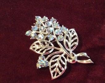 Vintage brooch silver metal flower shape aurora Borealis rhinestones