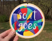 """hand embroidered hoop art: """"so it goes"""" quote from Slaughterhouse Five by Kurt Vonnegut"""